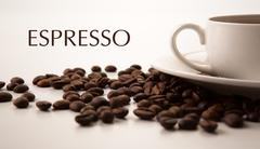 Cup of black coffee with roasted coffe beans with title espresso Stock Photos