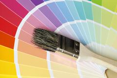 a brush lies on color tables - stock photo