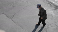 A man juggles two balls with his feet. Stock Footage