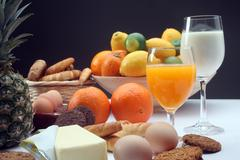 Breakfast with juice, milk, fruits and eggs Stock Photos