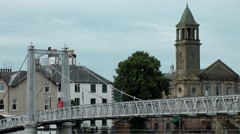 Scotland city of Inverness 007 modern bridge and old bell tower at Ness river Stock Footage