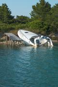 Sunken Speedboat - stock photo