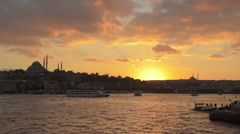 Suleymaniye Mosque, silhouette, Istanbul, marine traffic, golden horn sunset Stock Footage
