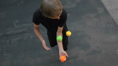 A man juggle balls on his arms, hands and feet. Stock Footage