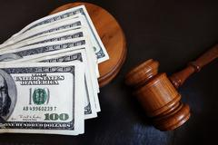 Stock Photo of Gavel with money