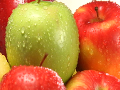 Rotating stack of red, green and yellow apples Stock Footage