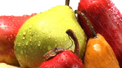Stack of rotating red, green and yellow pears Stock Footage
