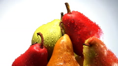 Rotating stack of organic red, yellow and green pears - stock footage