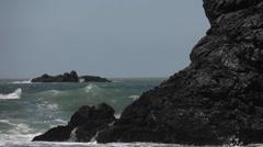 Heavy waves crash onto a rocky shore. Stock Footage
