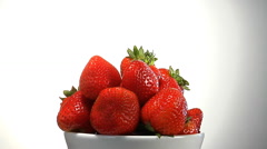 Slow zoom into bowl of organic strawberries Stock Footage