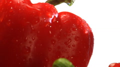 Yellow, orange and red peppers rotate in frame Stock Footage