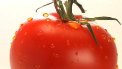 Red tomato rotates into and out of frame Stock Footage