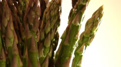 Close-up bunch of asparagus spear tips rotate in frame - stock footage