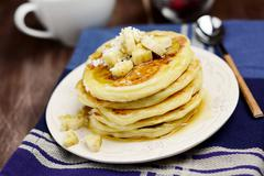 Pancakes with banana and maple syrup - stock photo