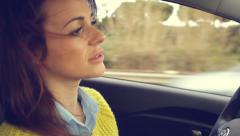 Closeup of woman driving car with wind in the hair Stock Footage