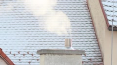 Smoke rising from the chimney in winter city Stock Footage