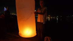 Girl with Sky Lantern at Night - Firework Festival/ Loy Krathong Stock Footage