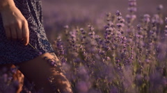 Close-up of girl's legs in lavender field Stock Footage