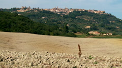 Italy, The Tuscan Countryside with the village of Montalcino in the background. - stock footage