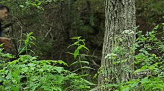 Hikers walking in the forest. Healthy young people living active lifestyle. - stock footage