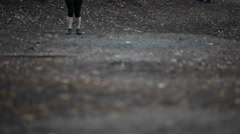 A woman seen jogging from below the waist. Stock Footage