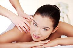 Stock Photo of Young woman relaxing in spa saloon