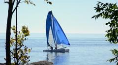 Catamaran and blue sails - stock footage