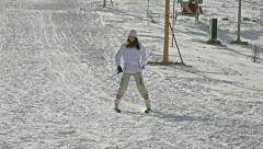 Skiing - young girl skiing down Stock Footage