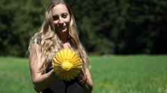 A young woman opens a yellow parasol and twirls it around her head. Stock Footage