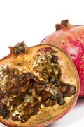 Rotten pomegranate on a white background Stock Photos