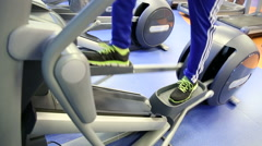 Man workout on elliptical equipmen - stock footage