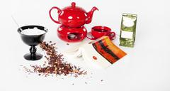 Tea, relaxation set for one person with book - stock photo