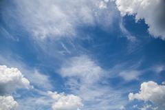 Cirrus and Cumulus Clouds - stock photo