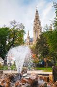 Fountain near Rathaus (Cityhall) in Vienna - stock photo