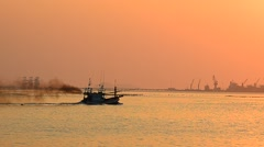 Silhouette of speed boat in the sea with sunset sky, Panning shot Stock Footage
