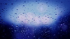 Rain on window glass bokeh light abstract background Stock Footage