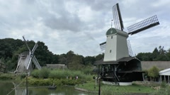 Two windmills in the Netherlands Open Air Museum, Arnhem, Netherlands. - stock footage