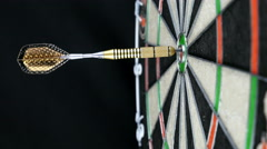 Close up of a single dart hitting the bull's eye on a dart board, 4K Stock Footage