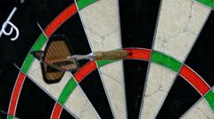 Close up of three darts hitting triple twenty on a dart board, 4K Stock Footage