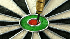 Close up of three darts hitting the bull's eye on a dart board, 4K - stock footage