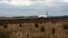Plane moving along runway Stock Footage