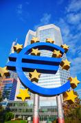 Euro sign in front of the European Central Bank building - stock photo