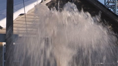 Broken city water main spews water on cold winter day Stock Footage