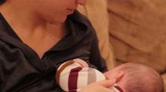 A mother nursing her newborn baby boy Stock Footage