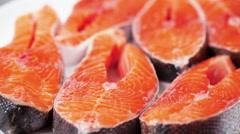 Close-up of few raw salmon steaks with salt. Rackfocus. Stock Footage