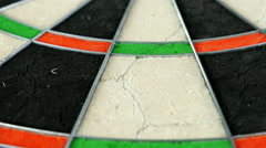 Close dolly on a dart board revealing the bull's eye with a dart, 4K - stock footage