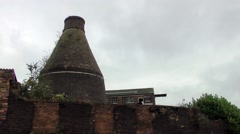 Old industrial Bottle kiln building against skyline Middleport Stock Footage