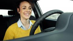 Stock Video Footage of cute woman talking happy with speakerphone while driving car