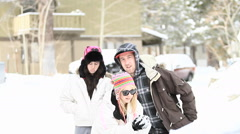A group of friends play in the snow. Stock Footage