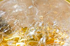 Bubbles in liquid - abstract nature background. Stock Photos